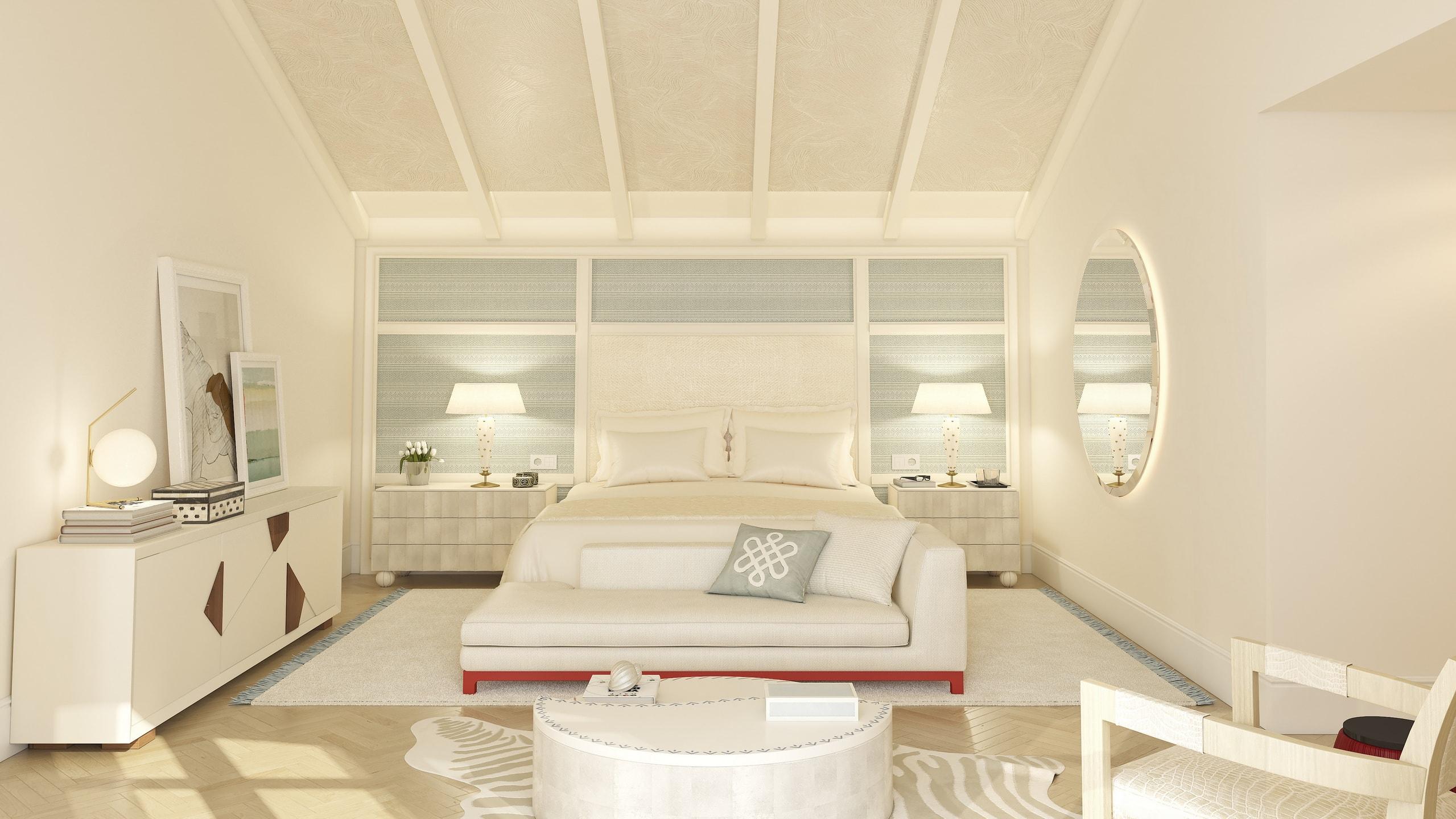 habitación de invitados con cama y sofá en color blanco.